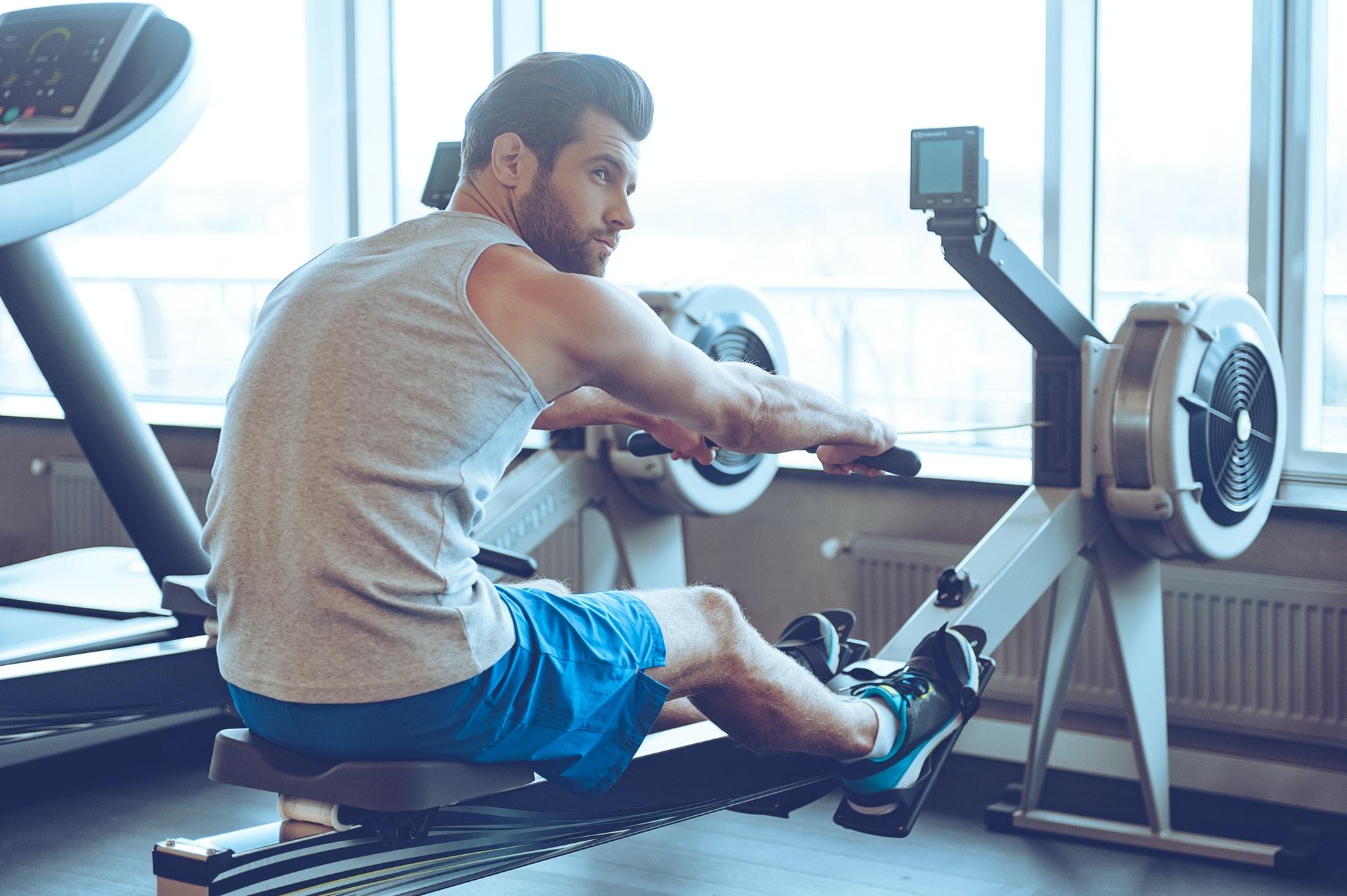 Rowing at gym.
